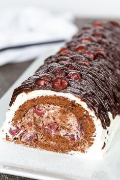 This Drunken Cherry Cake Roll is as luscious as it gets. This ultra-rich, sponge cake roll is the perfect dessert to make for your New Year's party. It is a traditional Russian cake, made with vodka-soaked cherries, cream and rich chocolate. New Year's Desserts, Cherry Desserts, Cherry Cake, Desserts To Make, Dessert Recipes, Russian Honey Cake, Russian Cakes, Chocolate Strawberry Cake, Chocolate Sponge Cake