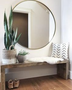 Modern Farmhouse entryway with large round mirror