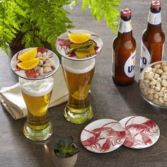 Wellfleet Wine Glass Topper Plates, Lobster | Designed to top wine glasses, this set of four mingle-friendly plates make it easy for guests to nibble on hors d'oeuvres while staying refreshed.