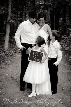 Family Wedding Picture...want to do this for our 5 year anniversary on the same beach we got married.