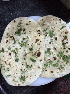homemade naan with fresh cilantro