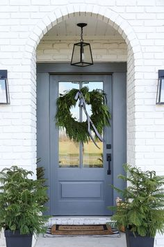 LIKE DOOR COLOR Benjamin Moore Kendall Charcoal and Benjamin Moore Chelsea Gray The paint color used on the front door a custom mix between Benjamin Moore Kendall Charcoal and Benjamin Moore Chelsea Gray Exterior Colors, Painted Front Doors, Door Design, Front Door Decor, Grey Front Doors, Exterior Door Colors, Painted Doors, Exterior Doors, House Exterior