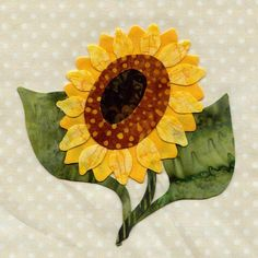 Sunflower-Find several nice flower blocks here. I'm going to pick 4 and make a wall quilt. Can't wait!