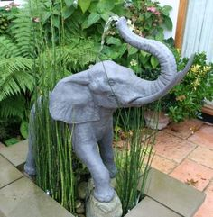 One of a pair of statues holding a jardiniere. The other is a Child with Goat Jardiniere. Also available as a fountain. Imported from England. To learn a bi Elephant Love, Elephant Art, Elephant Stuff, Elephant Quotes, Mandala Elephant, Elephant Jewelry, Elephant Gifts, Garden Statues, Garden Sculpture