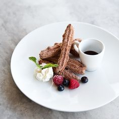 A churro with all our favorite accoutrements: berries, cream and chocolate.