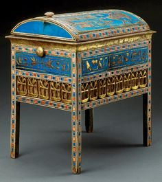 Tuyu's Box With Vaulted Lid. Decorated with ivory, ebony, blue faience, and gilding, this wooden chest was found in the tomb of Yuya and Tuyu, great-grandparents of King Tutankhamun.