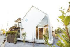 'House H' is located in Matsudo, Chiba, Japan.  Placing the roof in first place on site and arranging eight Y-shaped wooden frames, the last step was hooking up two floors to the wooden structure. Depending on the level and location of the floorboards, the distance from the big roof and other living space changes creating several living spaces divided loosely by the Y-shaped frames as well as the floorboards.