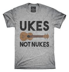 c6a1160ba You can order this Ukes Not Nukes Funny Ukulele t-shirt design on several  different