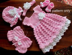 You can download one PDF file- including both the pattern for the dress , hat and Mary Jane shoes, headband and shrug in 4 sizes -newborn, 0-3 months, 3-6,6-9,-9-12 months