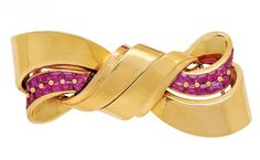 A Retro Ruby and Gold Double-Clip Brooch, circa 1935  The curving shield-shaped scrolls designed to combine to form a flowing ribbon bow, decorated with calibré-cut rubies, mounted in 18k gold, French assay marks