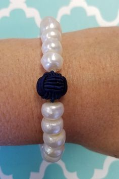 Every nautical loving gal needs this navy knot and pearl bracelet in her jewelry collection. Simple, classic, perfect!  Get yours today!  Shop: https://www.shoppinwithsailin.com/collections/bracelets/products/navy-nautical-knot-pearl-bracelet?utm_content=bufferba551&utm_medium=social&utm_source=pinterest.com&utm_campaign=buffer  Navy Nylon Knot Potato Pearls Made in USA FREE SHIPPING!!!