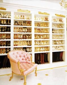 Mariah Carey's shoe closet looks more like a department store than a closet space. The shoes are so beautifully arranged that they become part of the decor and help to complement the other gold accents on the silk tufted chair, marble floors, and chandelier.