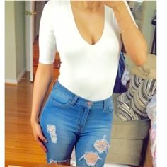 White 3/4 sleeve bodysuit NEw without tag: Retail white bodysuit. 3/4 sleeves. Double lined in the front and can be worn with or without a bra. snap closure at the bottom.. Very stretchy. Thong back.                                                                   Like this listing and you will be alerted when it arrives.Price is firm on retail items. Tops