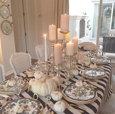 elegant black and white halloween table with white pumpkins