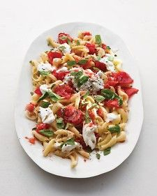Here's a formula for effortless summer food: the freshest ingredients plus a cook's restraint. Take this pasta. Just tear some bright-red tomatoes with your hands, pluck a little basil, and toss with seasoned pasta and dollops of creamy cheese. Crack black pepper on top, and dinner is ready.