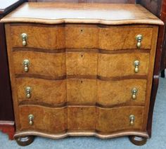 An 18th century style continental figured walnut chest of four long graduated serpentine drawers on bun feet, 73cm wide.