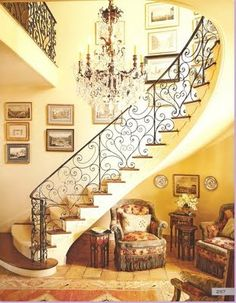 love the stairs, chandelier, sitting area and color palette