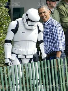 """Annual White House Easter Egg Roll, Washington D.C, America - 28 Mar 2016 United States President Barack Obama walks towards the storybook area """"protected"""" by a Star Wars storm trooper as he and first lady Michelle Obama host the 2016 White House Easter Egg Roll on the South Lawn of the White House in Washington, DC. 28 Mar 2016"""