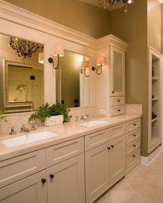 Traditional bathroom featuring elegant furniture and two minimalist undermount sinks