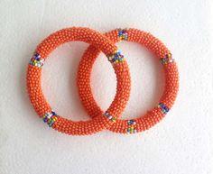 Handmade Orange Roll-on African Beaded bracelet by SipsHouseofDesign on Etsy