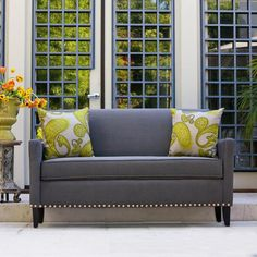 This angelo:HOME Sutton sofa was designed by Angelo Surmelis, combining modern lines with traditional details. The Sutton sofa has a slightly flared arm and is covered in a plush sliver gray ribbed velvet fabric.