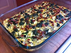 Paleo Breakfast Casserole   24 eggs  8 strips of cooked bacon cut into small pieces   2 full strips of cooked bacon (set aside)  ½ red onion (diced)  1 large yellow squash (chopped)  2 small or 1 large zucchini (chopped)  2 cups of frozen chopped spinach  1 tbsp rosemary  2 tbsp garlic powder  2 tsp oregano  Salt and pepper to taste