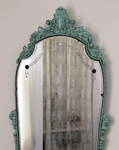 """Aqua painted antique etched mirror. Carved Wood Gesso Frame. Refinished in aqua with dove grey glaze to bring out the details. Likely from the 1920s-1930s, with original metal rosettes. Frame: 36"""" tall x 21"""" at widest point. Mirror: 30"""" tall x 18"""" wide. ~ $235 by WildMountainStudio on Etsy https://www.etsy.com/listing/228390906/antique-etched-mirror-aqua-victorian"""