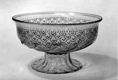 Bowl; glass; upper part decorated with deep band of scales in gold with raised enamel dots; lower part ribbed with diagonal gadroons; ribbed foot.