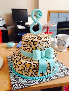 Hand painted cheetah cake with teal accents  by Jen Kwasniak