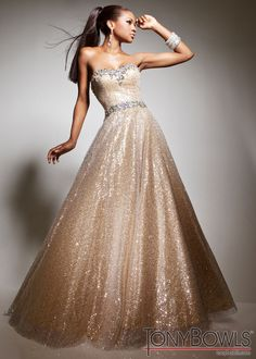 Buy now Tony Bowls Le Gala 113513 sequined strapless gold dress. I would absolutely love to wear a gold dress for my wedding.  in the mortal instruments series, gold is the color of the blood of the Angel and is worn in shadowhunter weddings ^.^