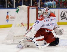 Washington Capitals goalie Braden Holtby defends the net during the second period of Game 3 of a first-round NHL hockey playoff series against the New York Islanders, Sunday, April 19, 2015, in Uniondale, New York. (AP Photo/Seth Wenig)