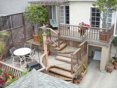 Multi level Redwood deck with spiral platform stairs.