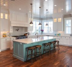 White Kitchen with a contrasting island adds a pop of color. #kitchenislands #lovingturquoise