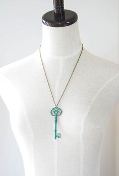 Rustic Verdigris Patina Large Skeleton Key Pendant Necklace. This rustic vintage style necklace features a large brass key pendant suspended from antique brass cable chain. The patina finish is individually hand done by me, so each piece may vary slightly but guaranteed to be as beautiful as the one pictured.  Measurements:  Key pendant: approx. 3.2 inches tall (82mm)  Chain length: You can choose your desired length from drop-down menu.   ♥ To see more of my handmade necklaces, please click…