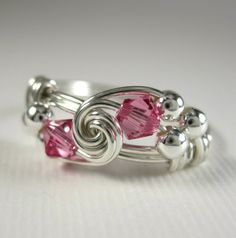 She makes the prettiest wire wrapped rings!  Pink Ring Wire Wrapped Rose Zircon and Sterling Silver Duet -- Any Size -- All Birthstones and Other Colors Available. $23.00, via Etsy.