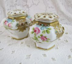 Shabby Chic vintage salt and pepper shakers- hand painted porcelain. $18.00, via Etsy.
