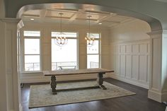 coffered ceilings, board and batten walls, heavily trimmed windows and edges
