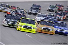 Four-wide #UNOH225  Matt Crafton (88) Toyota Tundra leads a four-wide pack in the UNOH 225 NASCAR Camping World Truck Series event at Kentucky Speedway in Sparta, KY.