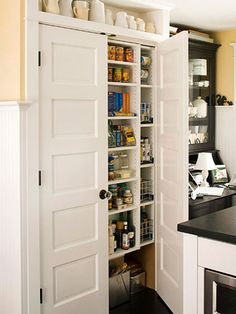Pantry Organization Ideas: Use the space between wall studs to build a pantry. The shallow space keeps everything front and center.