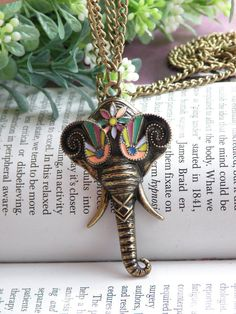 Elephant head pendant necklace -- however, I'd hang this from my car mirror. :)