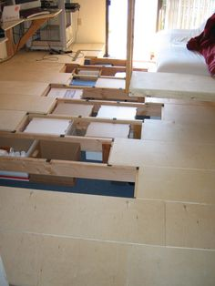 Underfloor storage in bedroom / office. Spaced at the perfect height and width for standard file boxes.