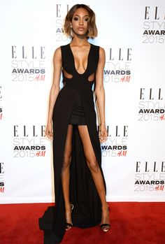 Jourdan Dunn in a black dress with a long train, plunging neckline, and cut-outs at the 2015 Elle Style Awards