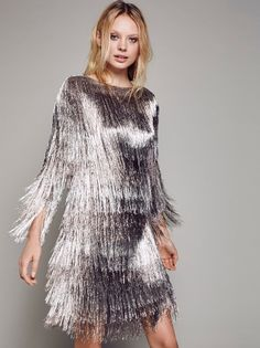 Mauve Dress | Sparkle and shine in this pretty party-ready dress with eye-catching metallic fringe cascading throughout. Fully lined.
