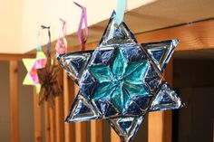 tinfoil star of david in the style of mexican tin art. i love the sharpie and foil work and have used it for shrines now i get to use it for more!