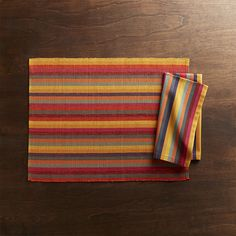 Fiesta Multi Stripe Placemat. Our Fiesta placemat made of yarn-dyed cotton sets a festive table in a rainbow palette of sunny shades.