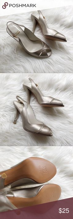 Stuart Weitzman Silver Heels This is a beautiful pair of Stuart Weitzman silver heels. Size 6. No real signs of being worn. Real leather sole. Stuart Weitzman Shoes Heels