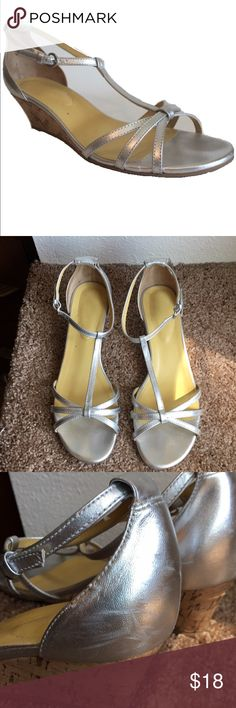 Silver strappy wedge Boden sandals, sz 10 In great used condition (only worn a couple of times). Some minor scuffing on the heels but no scratches in the leather. These wedges are approx. 2 inches tall, so really walkable. The silver color is so much fun! Boden Shoes Sandals
