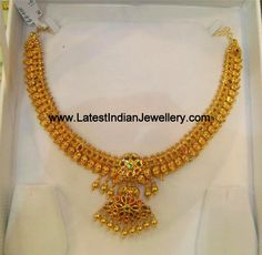 Traditional south Indian gold necklace in mango/paisley design with traditional ruby double step pendant also popularly known as mamidi pindela necklace. Gold Earrings Designs, Gold Jewellery Design, Necklace Designs, Gold Necklace Simple, Small Necklace, Bold Necklace, Short Necklace, Necklaces, Gold Wedding Jewelry