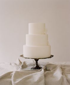 white and clean; classic (but frosting not fondant so a little less perfect)