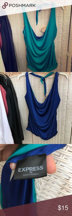 Express Reversible Halter Top Hmmmmm...what color should I wear tonight?!? Royal blue? Emerald green? Decisions, decisions....what color would YOU wear on this cute halter? Ties around the neck and has a sexy open back. Waist is elastic and sits just above the hips.  Having a reversible halter top is great too if you spill something on you -just flip it to the other side! Express Tops Tank Tops